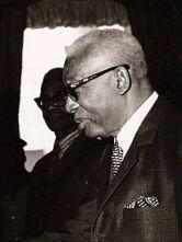 François Duvalier (Port-au-Prince, 14 aprile 1907 – Port-au-Prince, 21 aprile 1971) . Medico antropologo. Noto con il nome di Papa Doc, diviene presidente di Haiti dal 1957. Jacques Gabriel pittore di talento ha 23 anni quando Duvalier diviene presidente. La sua vita artistica è segnata da un presidente che nel 1964 diviene dittatore di Haiti.